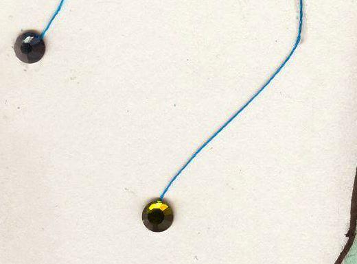 thread and rhinestone detail on fashion illustration